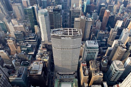 Office and residential buildings surround the MetLife building in this aerial photograph taken over New York, U.S., on Wednesday, July 7, 2010. Photographer: Daniel Acker/Bloomberg